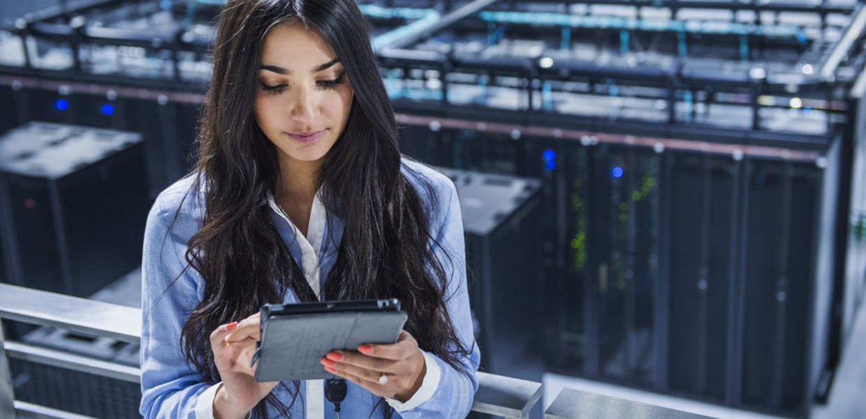 Woman in datacenter holding a tablet
